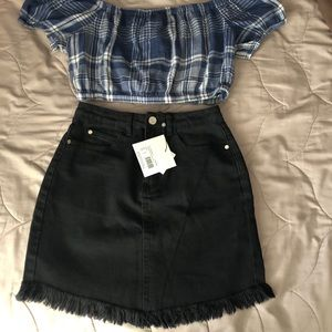 Distressed black skirt